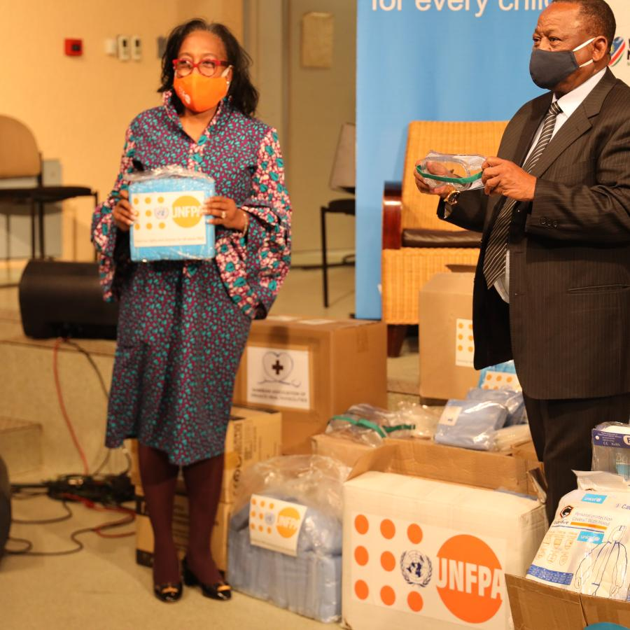 Dennia Gayle, UNFPA Representative pictured with Dr. Kalumbi Shangula during the handover
