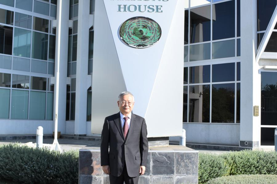 UN Resident Coordinator, Sen Pang pictured infront of the UN House in Namibia