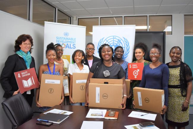 The Group of Namibian girls pictured with the UN Resident Coordinator a.i. and Ms. Edda Bohn from the Ministry of Education, Arts and Culture.
